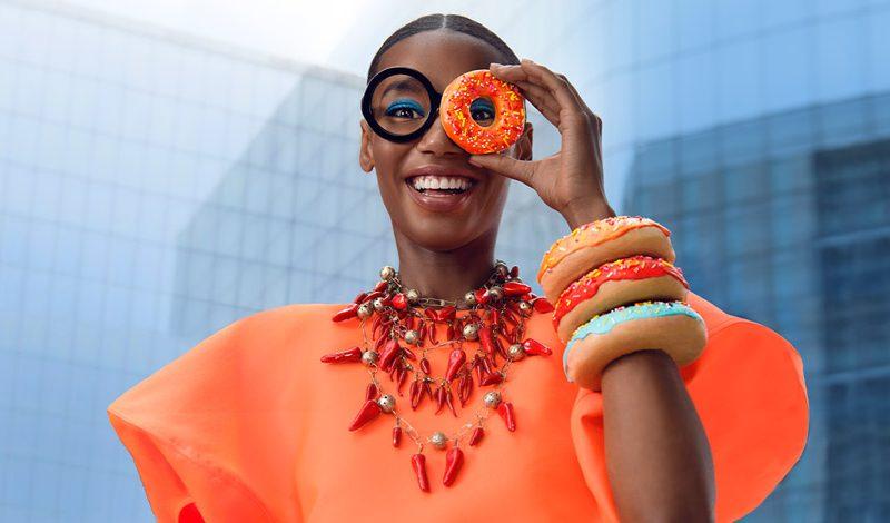 A woman enjoys donuts at CityCenterDC